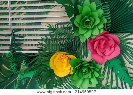 Beautiful artificial paper flowers and leaves background free space. Floral background copy space view from above. Holiday greeting card for Valentine's Day Woman's Day (March 8) Mother's Day