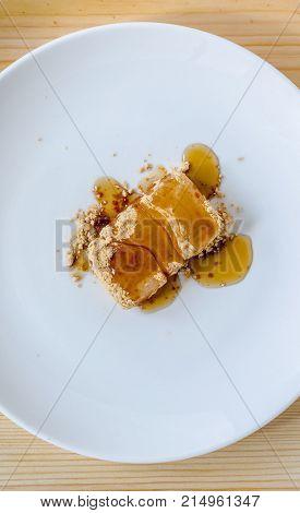 Tsukushi Mochi: Japanese Dessert On White Dish