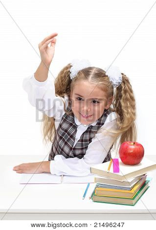 Young Girl At A Desk, Hand Raised