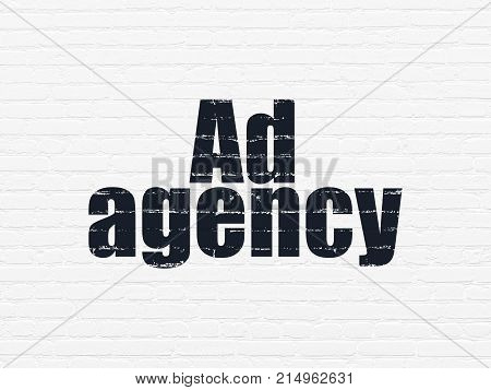 Marketing concept: Painted black text Ad Agency on White Brick wall background