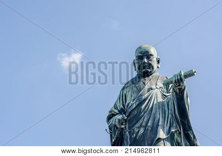 FUKUOKA JAPAN - NOVEMBER 6: The bronze statue of Nichiren Shonin a founder of Nichiren School a school of Buddhism in japan at NOVEMBER 6 2015 in FUKUOKA PREFECTURE JAPAN