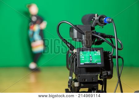 Saratov, Russia, November 21, 2017: Actress in theatrical costume in a television Studio. Green screen and chroma key. Lighting equipment and filming equipment.