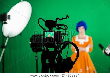 Saratov, Russia, November 21, 2017: The actress in the Studio on a green background. Video of the interview. Cameras and lighting equipment.