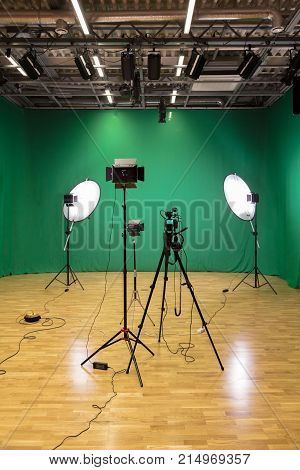 Studio for filming on a green background. The chroma key. Lighting equipment in the Studio. Green screen.