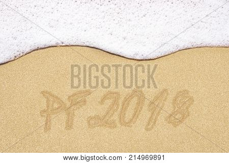Beach background with PF 2018 written in sand. Wave and sand border.
