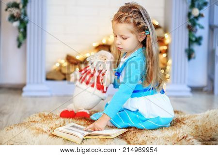 Child With A Toy. How To Instill A Love Of Reading Concept New Y