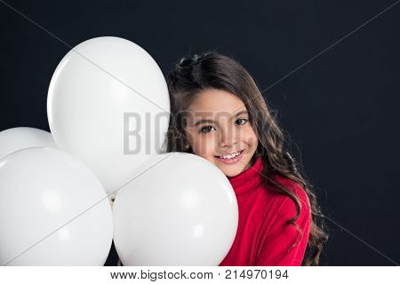 Kid With Helium Balloons