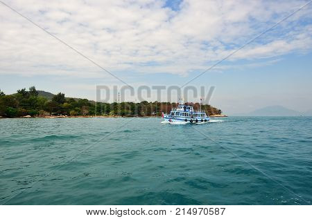 Koh Samet Thailand - Jan 04 2012: Ferry boat brings tourists to the small island of Koh Samet. Koh Samet is easy to reach from Bangkok and became famous for Thai tourists.