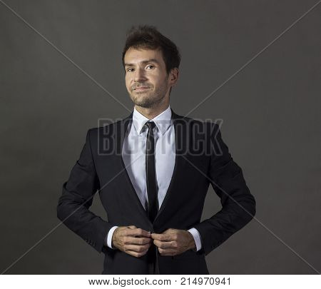 Portrait Of A A Cheerful Gentleman In Business Attire.