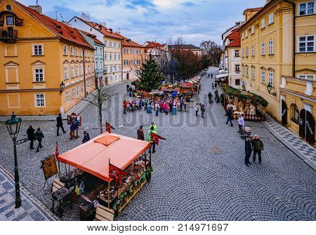Rague, Czech Republic - December 22, 2015: Wooden Stands Offering Souvenirs And Traditional Food Dur