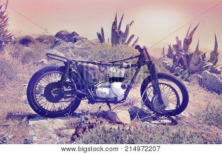 old motorcycle abandoned in a barren landscape