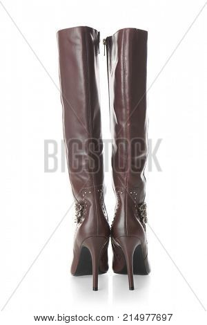 Pair of female high boots on white background