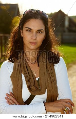 Pretty woman outdoor in the countryside. Casual clothing, hispanic look. Natural light afternoon late summer autumn sunlight.
