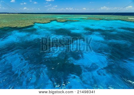 Beautiful CloudsReflected in Water at Clam Gardens In Great Barrier Reef Park