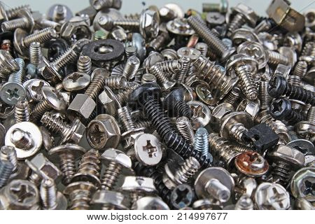 Nuts bolts. Nuts and bolts. Screw, tweak, bolts, twist, maternal, nut screw or nut background. Screws and bolts as texture. Pattern background