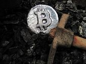Bitcoin mining. A mine with real hardware. Symbols of block chain technology for crypto currency - metal coin, coal, pickaxe. Background for cryptocurrency and ICO transactions poster
