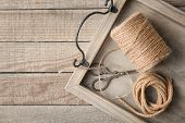 Tray with hank of hemp twine and rope on wooden background poster