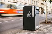 A modern clever trash can on the street in Prague in the Czech Republic. Collection of waste in Europe for subsequent disposal. Eco-friendly waste collection poster