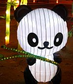 A panda shape lantern displayed in a festival. poster