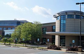 Newark, Delaware USA - May 30, 2014: A modern medical office building on a hospital campus housing physician practices and other health care services
