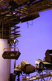 Professional lighting equipment in studio with Blue screen