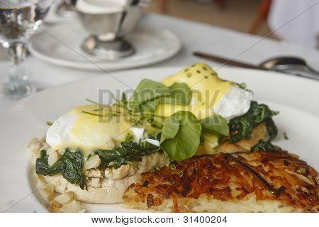 Hashbrown Potatoes And Eggs Florentine Benedict