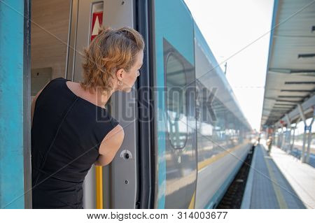 Businessman With Luggage Traveling By Speed Train At Business Meeting About Transport