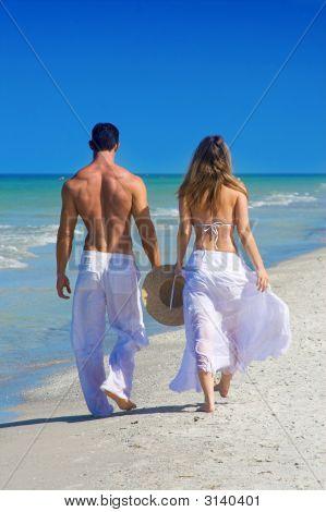 Couple Walking At Beach