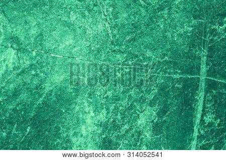 Vintage Green Background. Rough Painted Wall Of Emerald Color. Imperfect Plane Of Virid Colored. Une
