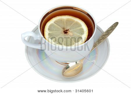 Cup of tea and sauser with lemon and spoon poster