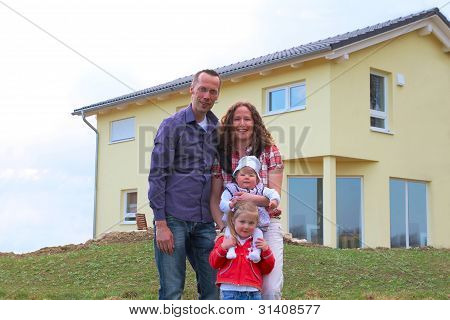 Family In Front Of Her House
