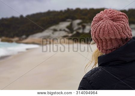 Girl In Beanie Looks Into Distance Along Beach, Hiking Girl In Nature Looks Off Into The Distance, N