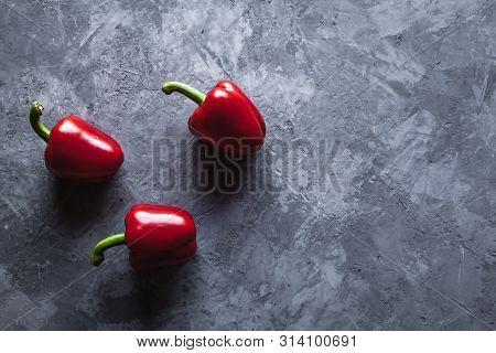 Fresh Pepper On Grey Background A Red