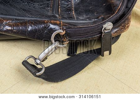 Fragment Of Old Black Handbag With Some Metal Bag Accessories