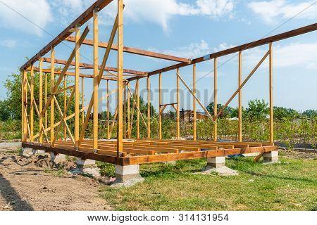 A Wooden Summerhouse Under Construction On Estate