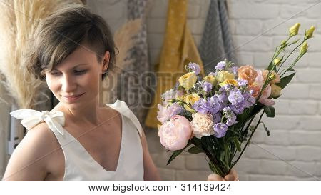 Portrait Of Woman Creating Flower Compositions In Art Studio. Teacher Of Floristry In Master Classes
