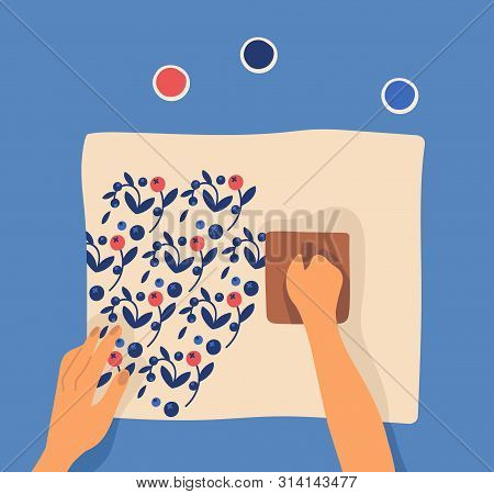 Hands Printing Pattern On Fabric Using Woodblocks And Paint. Leisure Or Pastime Activity, Craftwork,