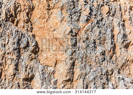 Background And Texture Of Mountain Layers And Cracks In Sedimentary Rock On Cliff Face. Cliff Of Roc