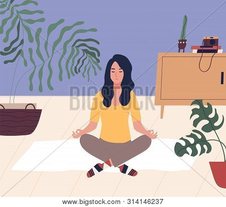 Young Woman With Closed Eyes Sitting Cross Legged On Floor And Meditating. Meditation, Relaxation At
