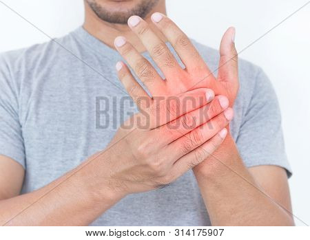 Young Man Massaging Him Painful Hand, Suffering From Hand Pain Isolated On A White Background.