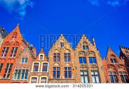 The Jan Breydel And Pieter De Coninck Statue Located In The Historical City Center And Market Square