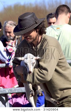 Shepherd And New Born Lamb