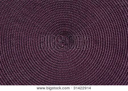 Close-up Of Dark Purple Synthetic Fabric.