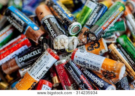 Delhi, India: Trash Batteries With Oxidation, Rechargeable Accumulators And Old Alkaline Batteries F