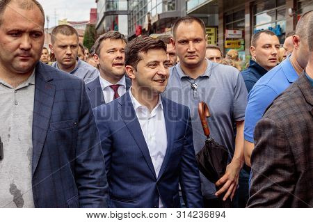 President Of Ukraine Volodymyr Zelenskyy (С), Surrounded By Personal Security, Walks Through The Cit