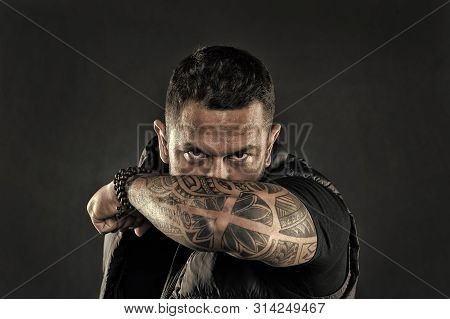 Tattooed Elbow Hide Male Face. Masculinity And Brutality. Tattoo Culture Concept. Man Brutal Unshave