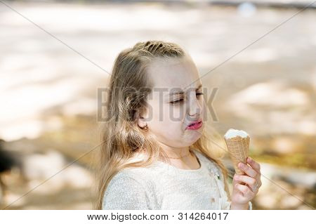 It Leaves A Bad Taste In The Mouth. Cute Little Girl Dislike Taste Of Ice Cream. Small Child Licking