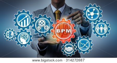 Unrecognizable Businessman Is Highlighting A Bpm Application Icon In A Virtual Gear Train. Concept F