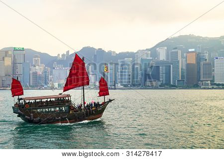 Hong Kong-nov 5th, 2016: View Of Hong Kong Island Harbour With Red Junk Boat Sailing With Passengers