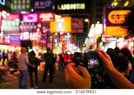 Kowloon, Hong Kong-nov 6th, 2016: Lighted Signboards And Signs Illuminated The Streets Of Kowloon. H